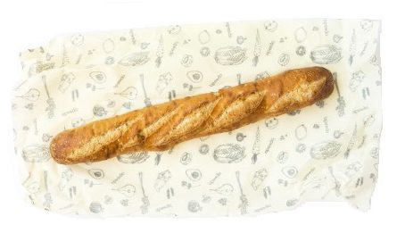 Image of Abeego Beeswax wrap with a baguette on top