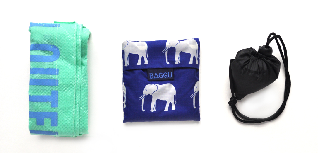 Image of three types of reusable bags: a green one, a blue one and a black one