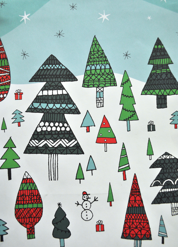 Image of Holiday Wrapping Paper with Christmas trees on a hill covered in snow