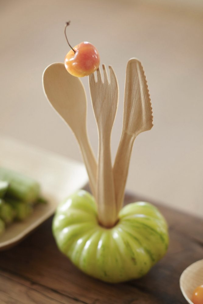 Image of Vertera Compostable Cutlery standing on top of a green tomato