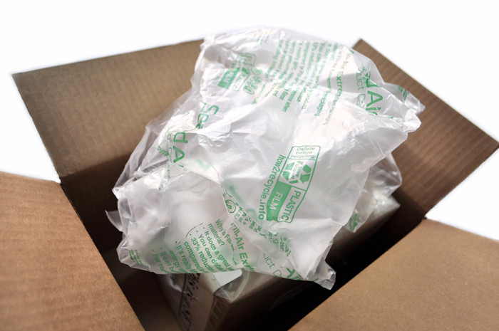 Image of an opened box with plastic air pillows coming out of it