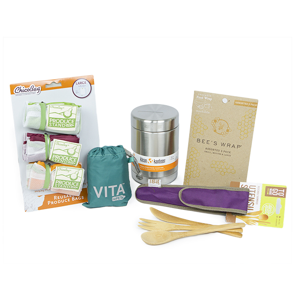 Image of produce bags, a reusable grocery bag, a food canister, bees wraps, and a bamboo utensil set