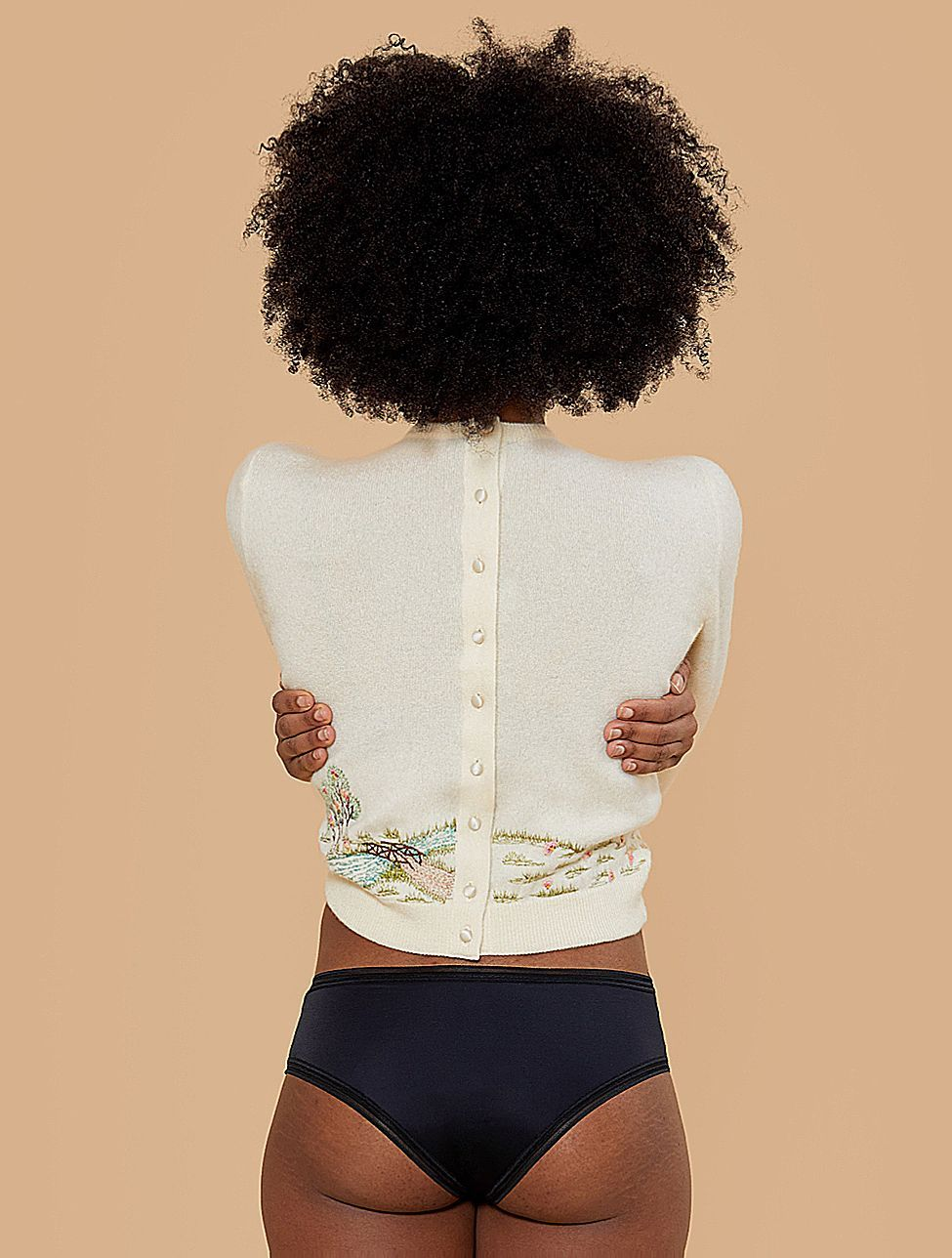 Image of a woman wearing a THINX Cheeky Period Panty