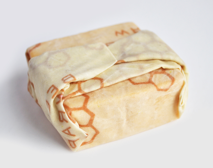 Image of a block of cheese wrapped in a beeswrap food wrap