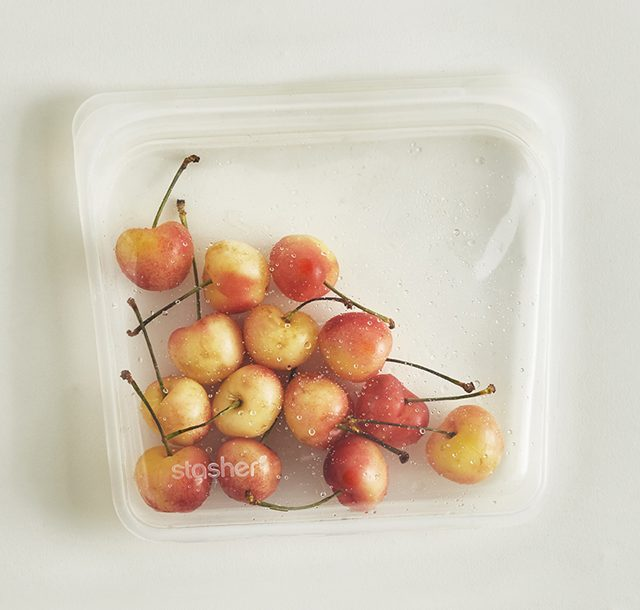 Image of a clear stasher bag filled with red and yellow cherries