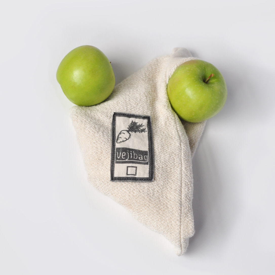 Image of an organic cotton vejibag with two green apples