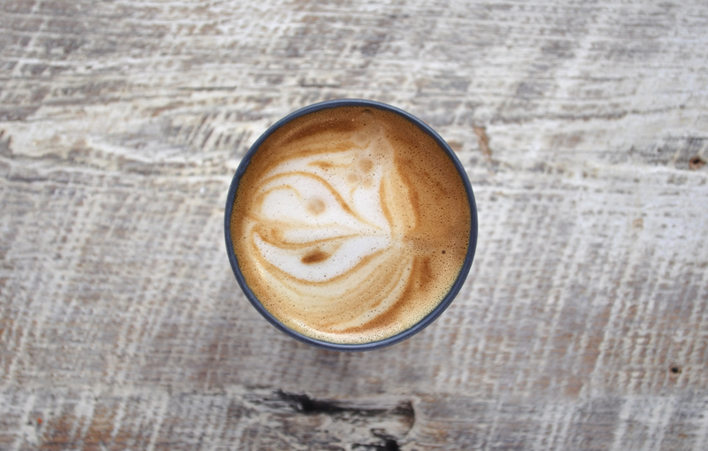 Image of an ecoffee cup filled with a latte