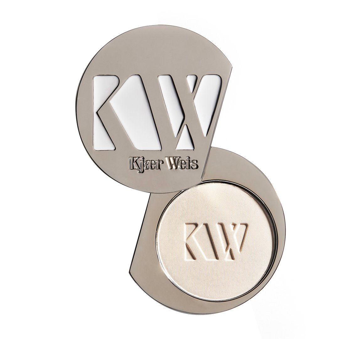 Image of a metal case of Kjaer Weis pressed powder