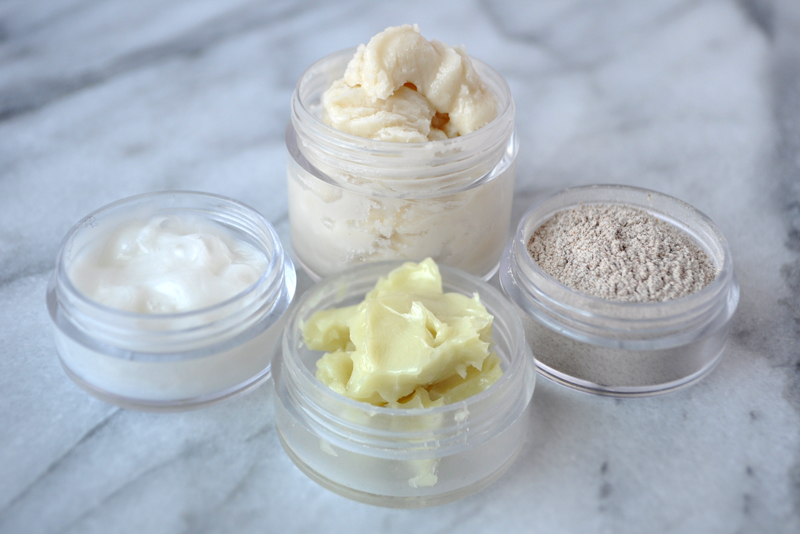Image of four plastic containers Travel Sized Containers containing deodorant cream, face wash, skin cream, and tooth powder