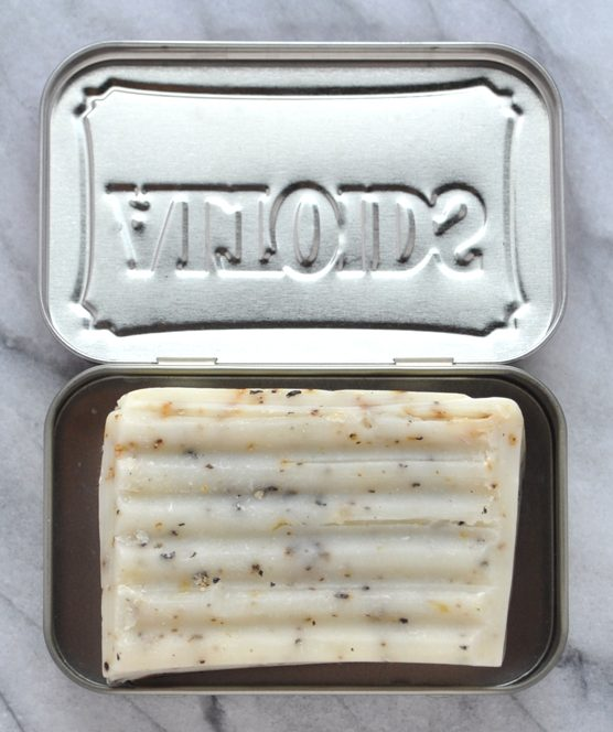 Image of a metal Altoids container with a bar of soap in it