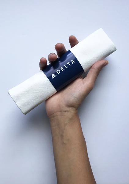 Image of a hand holding a white napkin