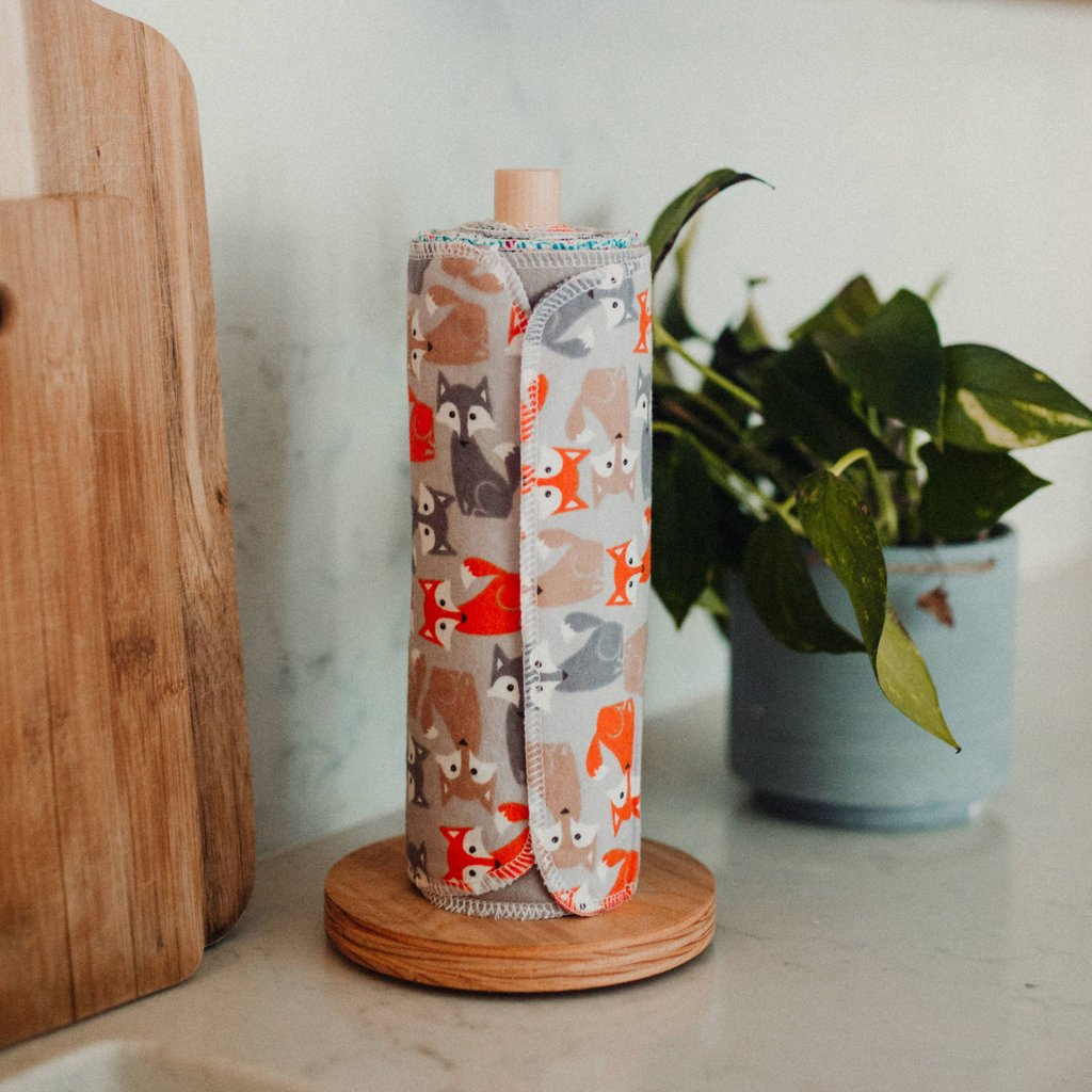 Image of Pre-rolled eco friendly Unpaper Towels with a wooden holder