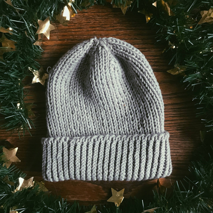 Image of a beanie made out of sustainable yarn, a perfect eco-friendly gift for the holidays