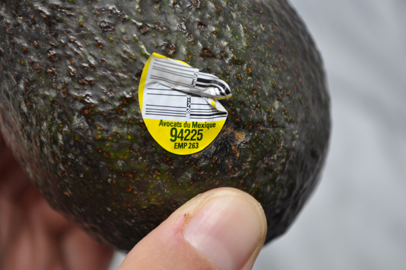 Image of an avocado with a yellow produce sticker on it