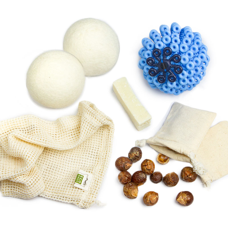 Image of eco friendly laundry detergent, wool dryer balls, a stain stick, a microfiber laundry ball, and a cotton mesh bag
