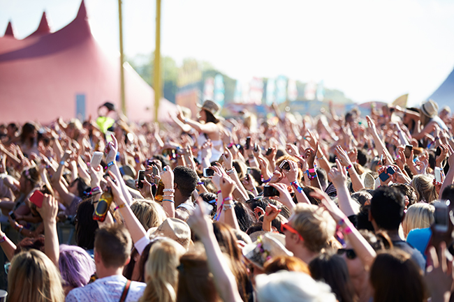 Image of Crowds Enjoying Themselves At Outdoor Music Festival