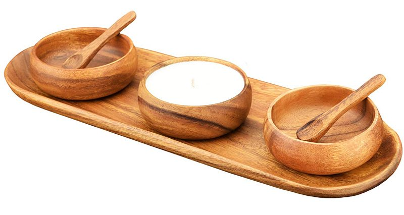 a picture of three handmade wooden serving bowls, spoons, and tray