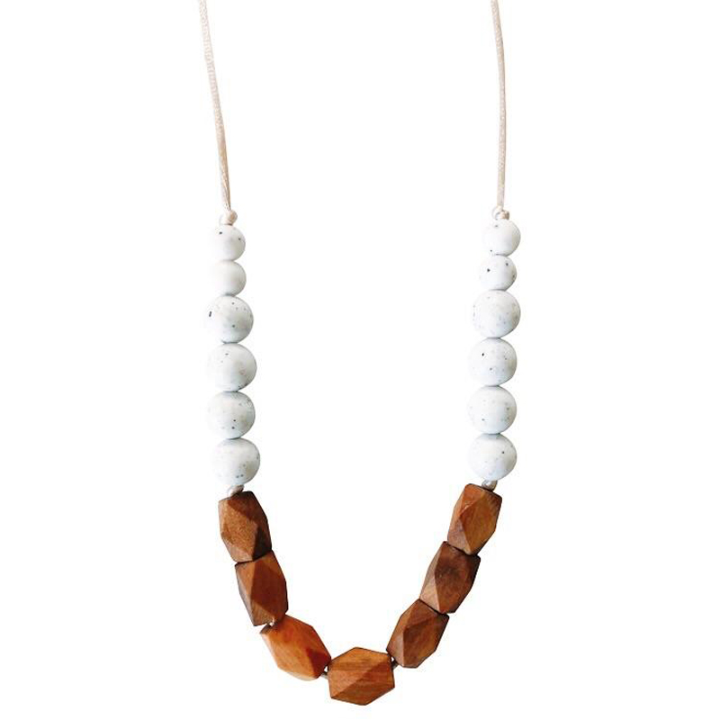 a necklace made from wooden beads by [x]
