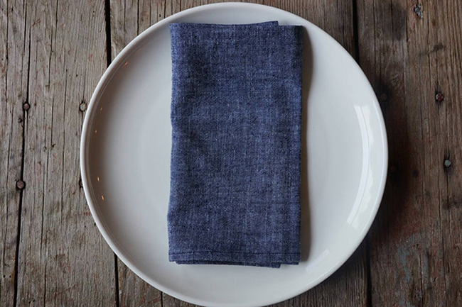 Image of a blue cloth napkin, one of the best eco friendly alternatives to paper towels