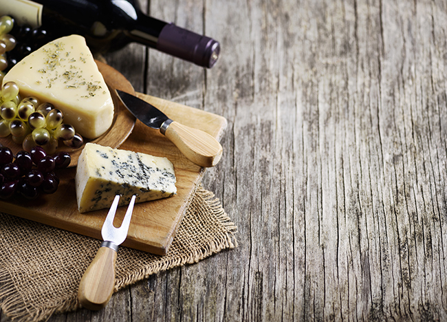 an image of a cheese cheese board and wine