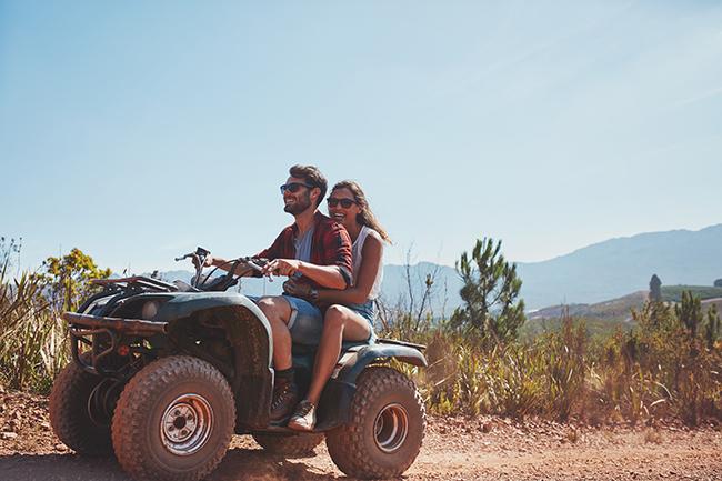 image of a couple riding a four-wheeler