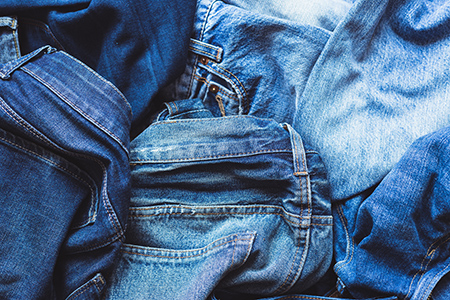 Image of a pile of jeans for clothing recycling