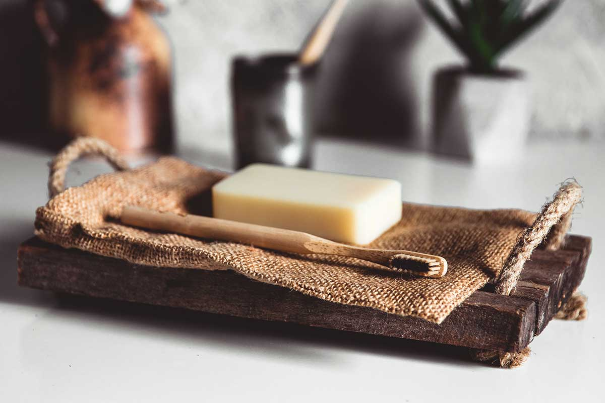 Image of a wooden toothbrush and soap