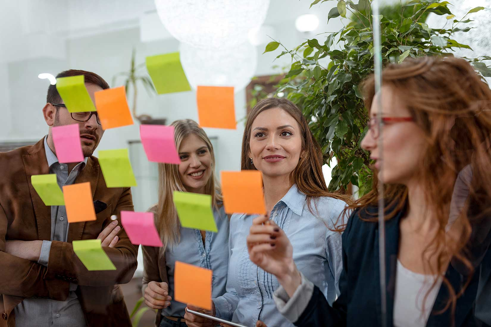 image of a sustainability consultant working with a team of people using colorful post-it notes