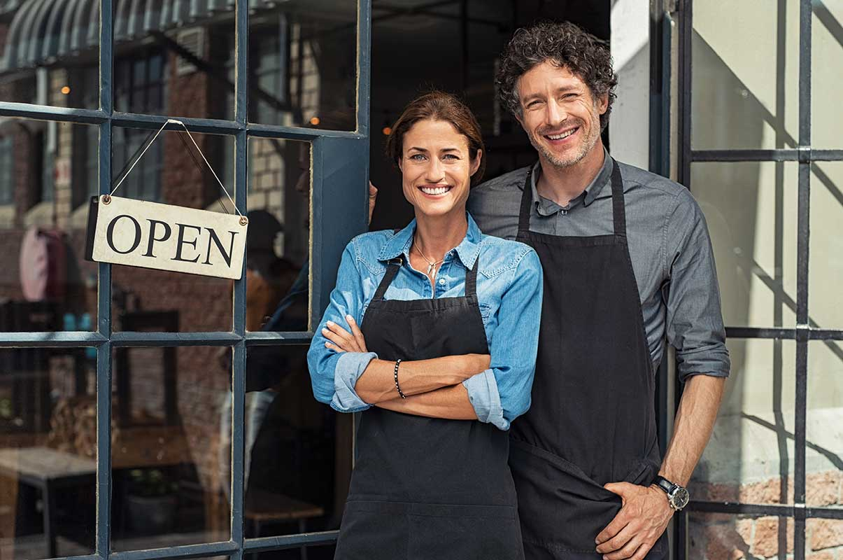 image of a couple standing in front of their small business