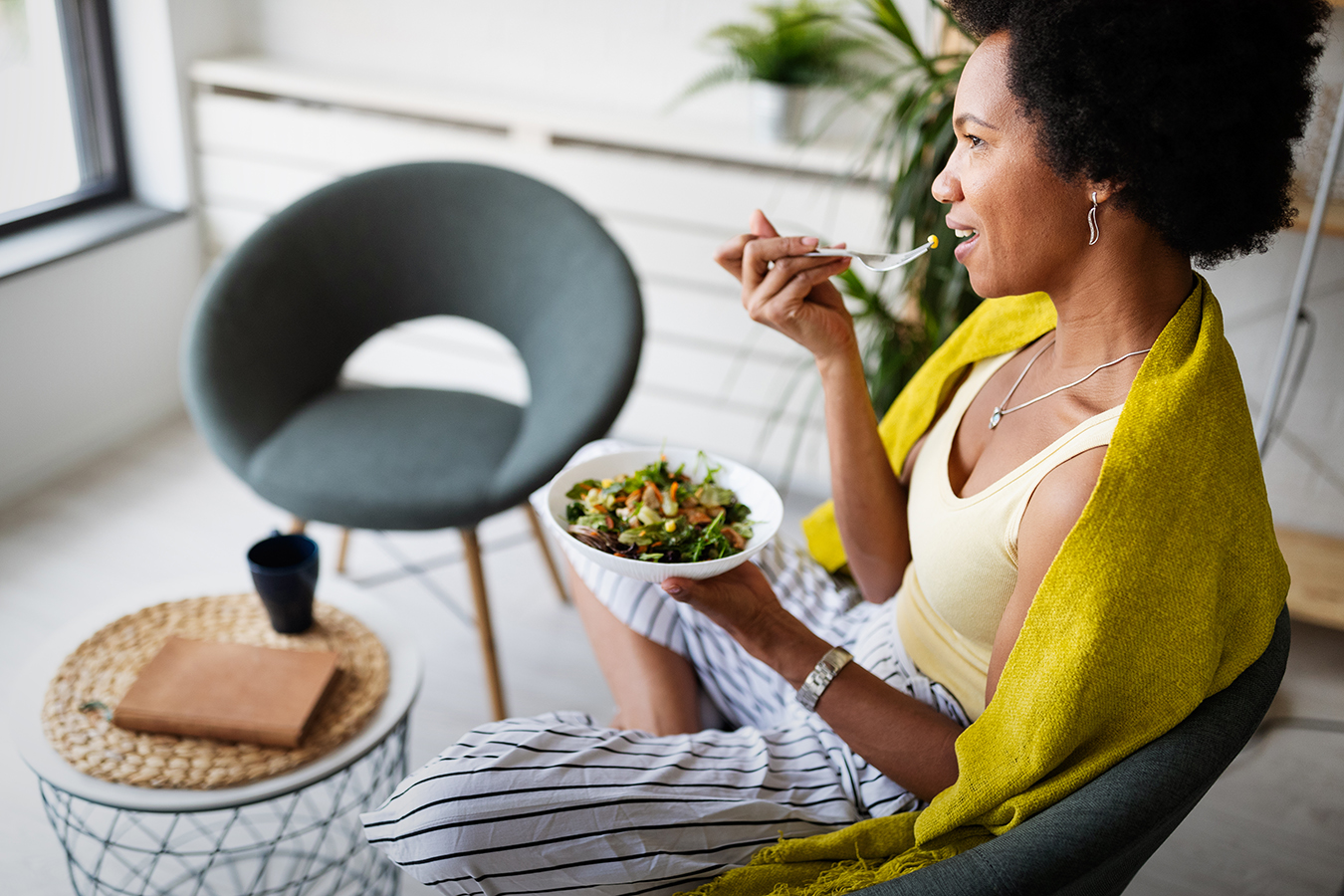 Image of a woman eating a salad